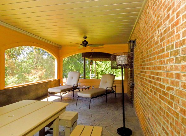 smith mountain lake virginia screen porch curved archway stone flooring