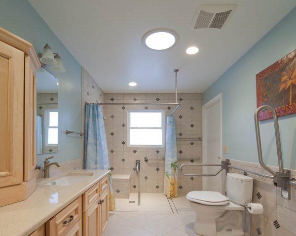 custom wheelchair accessible curbless shower grab bars roll under sink aging in place bathroom blue ridge virginia
